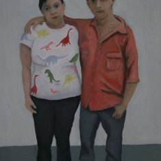 Damaris in her dinosaur shirt, with her boyfriend, six months pregnant.