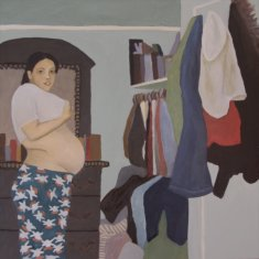 Damaris 8 months pregnant in her room.