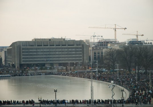 The crowds gathered around the reflecting pool.