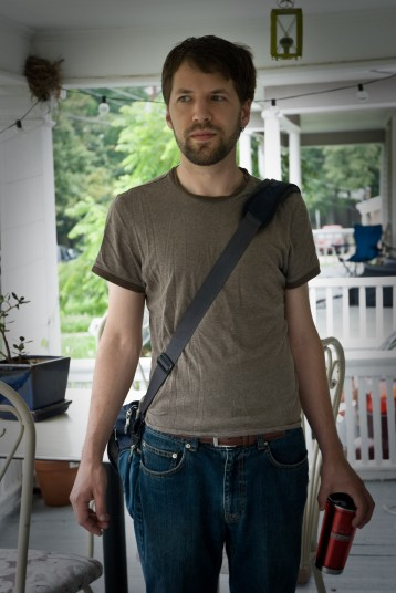 Eli on our old porch, leaving for his first day of being a full time employed web designer.