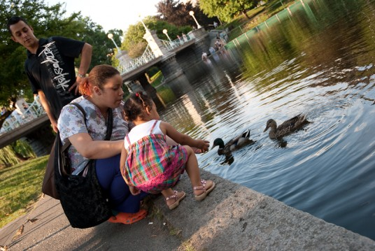 Andrea feeding ducks.